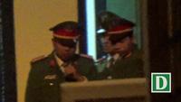 Ông Đinh La Thăng được che ô khi rời tòa. (Video: Toàn Vũ)