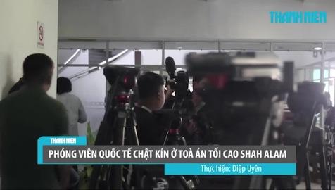 An ninh tại tòa án nơi diễn ra phiên xét xử Đoàn Thị Hương. Nguồn video: Báo Thanh niên