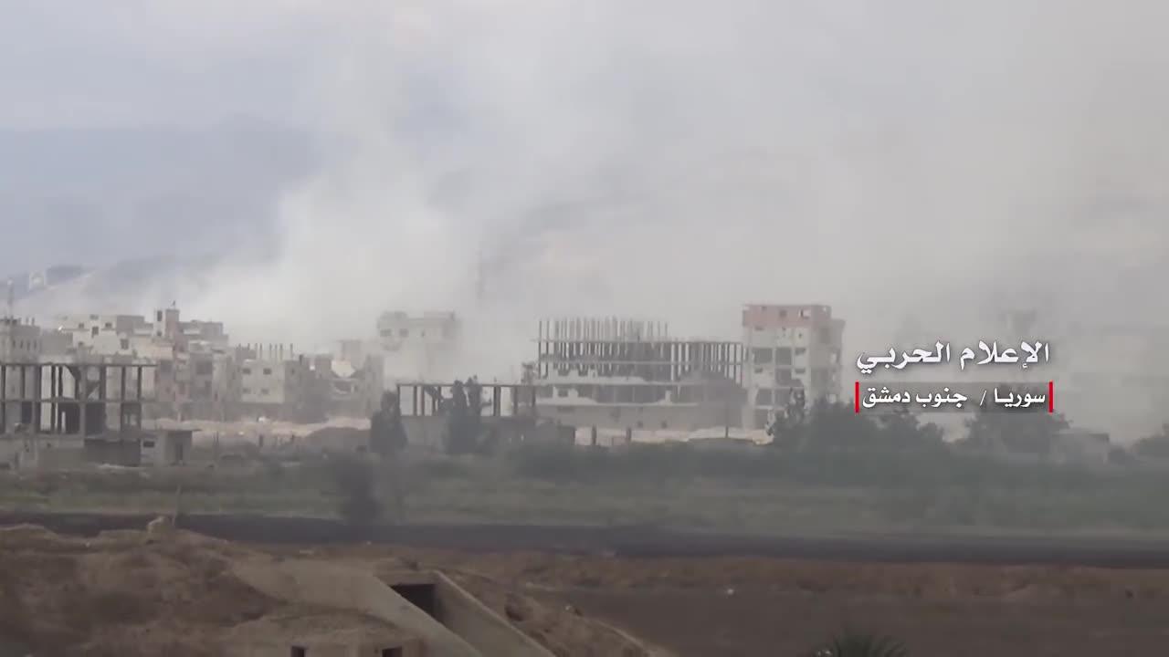 Lực lượng tên lửa, pháo binh quân đội Syria tấn công IS ở Yarmouk