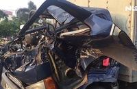 Xe tải cắm vào đuôi xe cẩu, tài xế chết cứng trong cabin