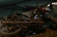 Trượt rãnh thoát nước, 2 người bị xe tải cán tử vong