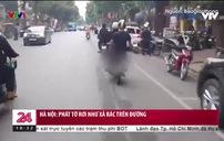 Nhóm thanh niên đi xe máy phát tờ rơi như xả rác