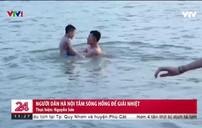 Hà Nội nóng hơn 40 độ C, hàng trăm người dân đổ ra sông tắm