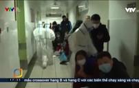 Các bác sĩ Trung Quốc căng mình ứng phó dịch bệnh lan rộng