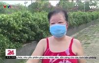 Nhiều người Hà Nội vẫn ra ngoài tập thể dục, chen chúc xét nghiệm